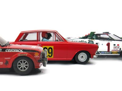 Three rally slot cars