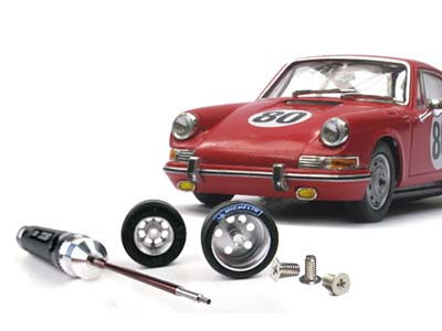 Porsche slot car with wheels and a screwdriver