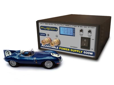 A Jaguar D-Type slot car with a power supply