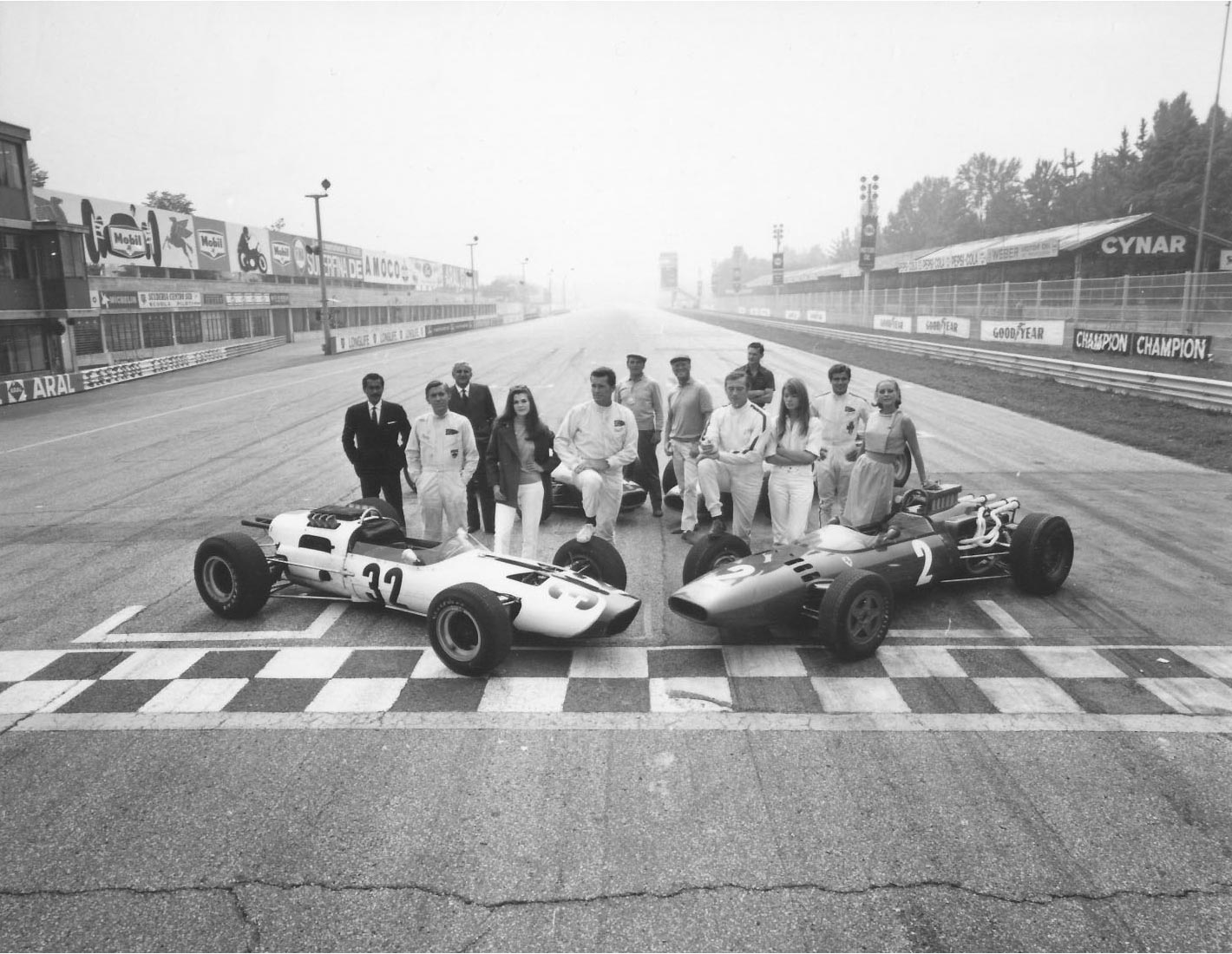 The cast of Grand Prix on the main straight at Monza