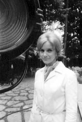 Eva Marie Saint standing in the garden