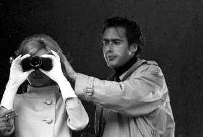 Eva Marie Saint looking through binoculars and John Frankenheimer