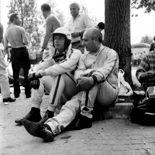 Yves Montand and Juan Manuel Fangio chat