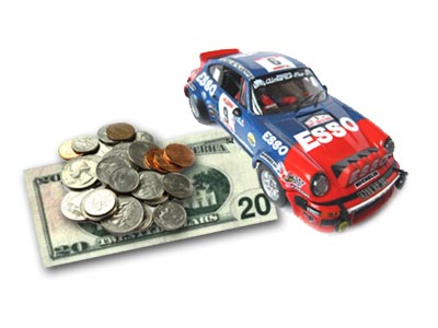 Fly Porsche slot car with a £20 note and some coins