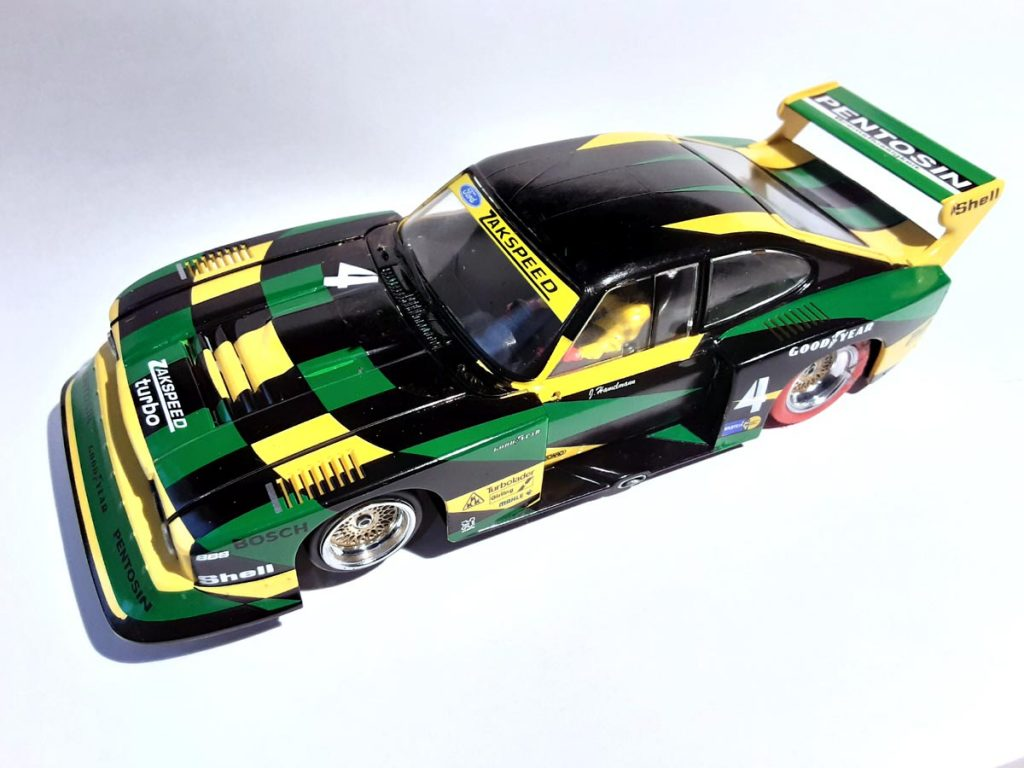 Gren, yellow and black RacerSideways Ford Capri with aggressive spoilers and wheel arches