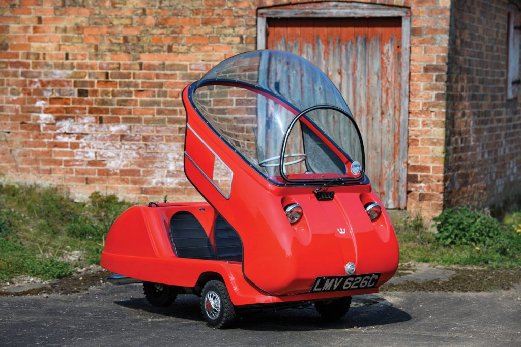 Tiny red Peel Trident microcar
