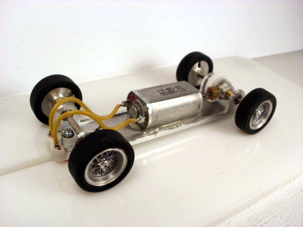 Scratch built aluminium chassis with wheels, guide, and motor mounted