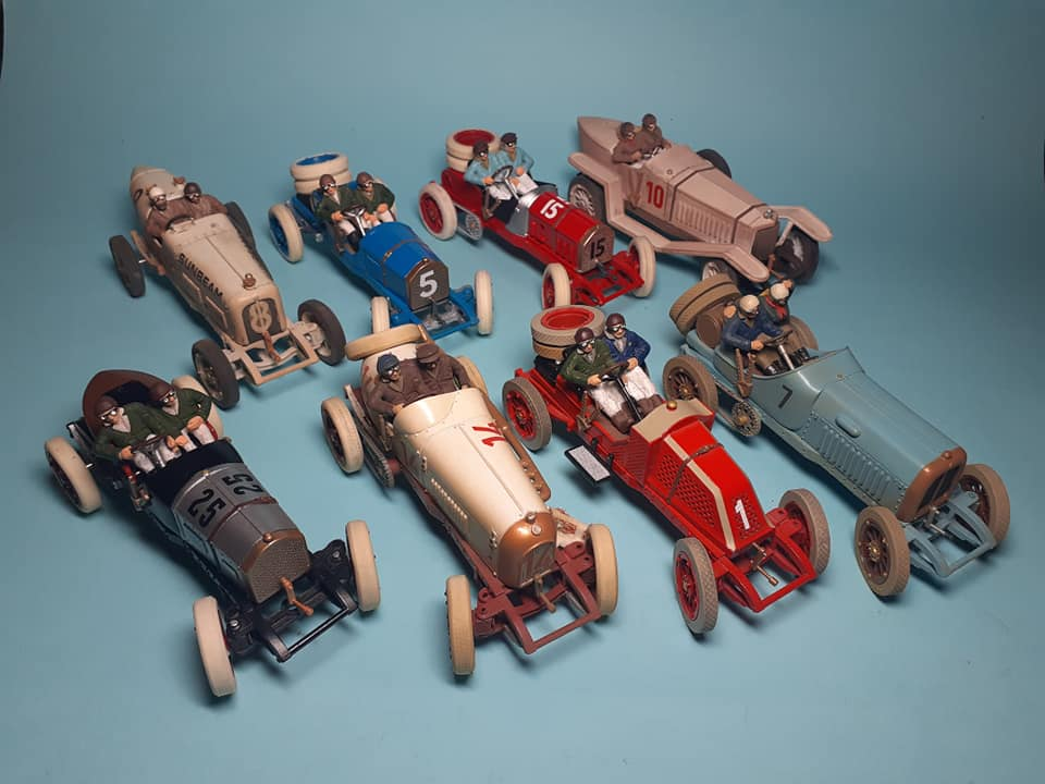 Eight old fashioned race cars