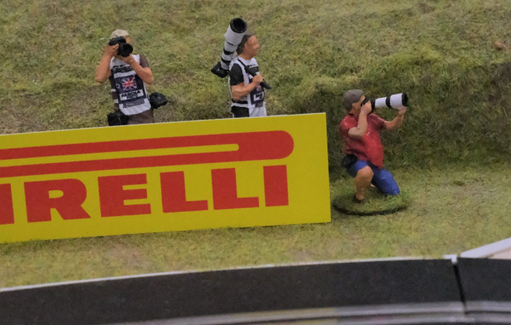 Three motorsports photographer figures