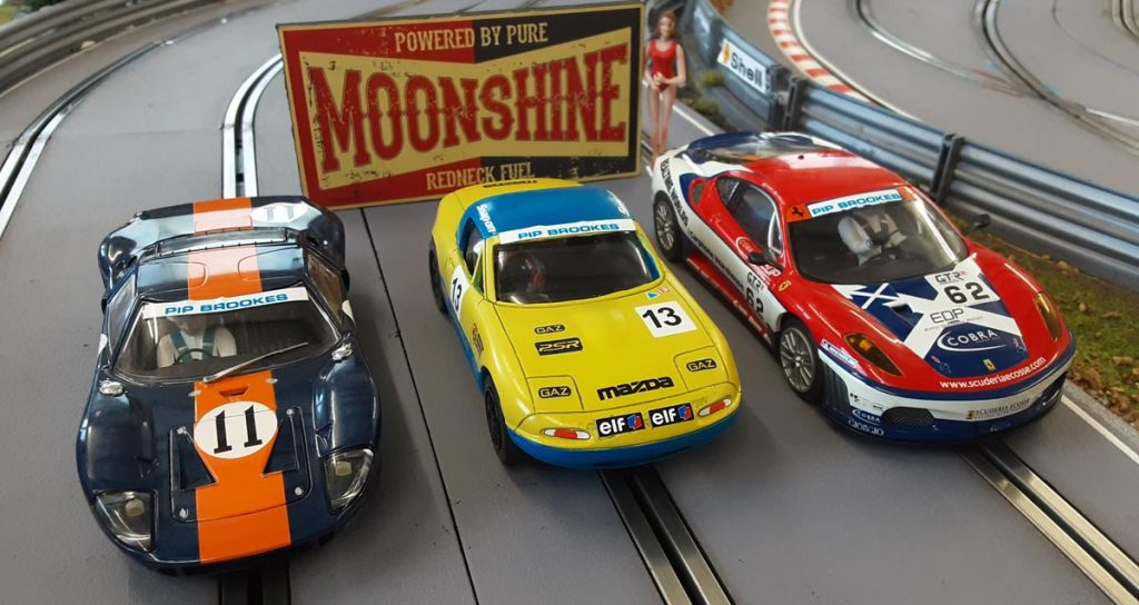 Three slot cars entered in the the Brighton to John O'Groats Road Race
