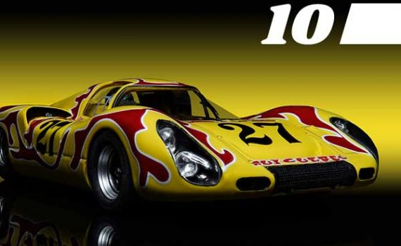Yellow and red Porsche 907 slot car