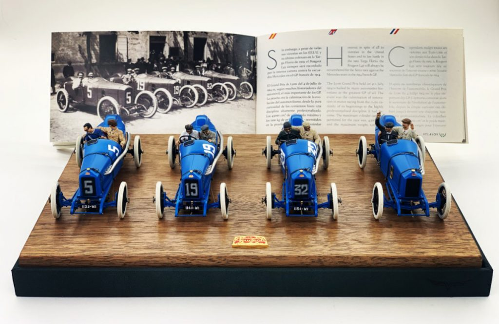 Four blue Velasor Peugeot models