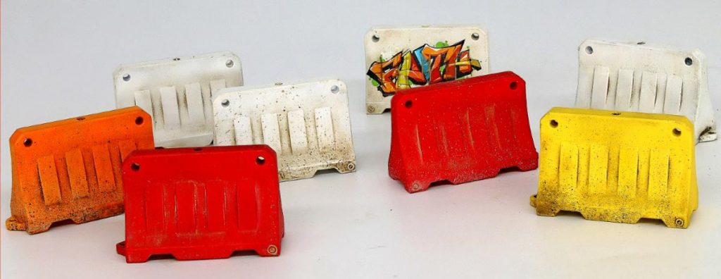 Miniart model road barriers in red, yellow, and white