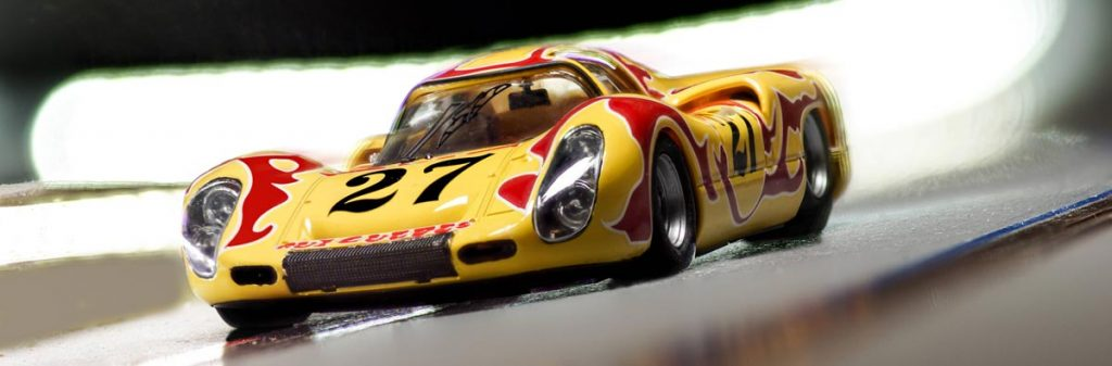 Yellow and red Porsche 907