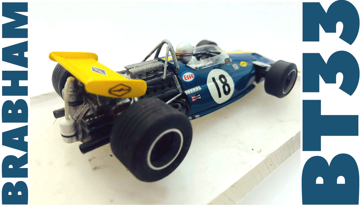 Blue and yellow Brabham BT33 slot car