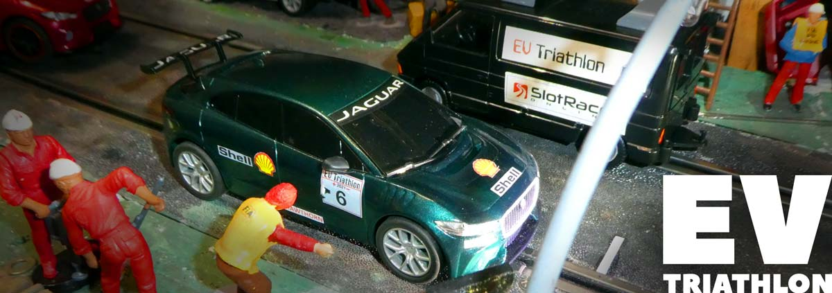 Green Scalextric Jaguar I-Pace on the start line of the EV Triathlon