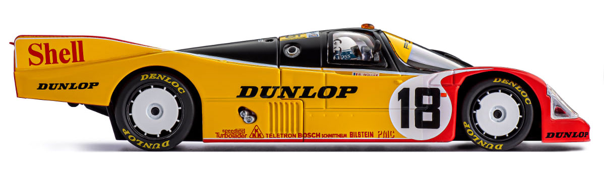 Porsche 962 in black, yellow, and red