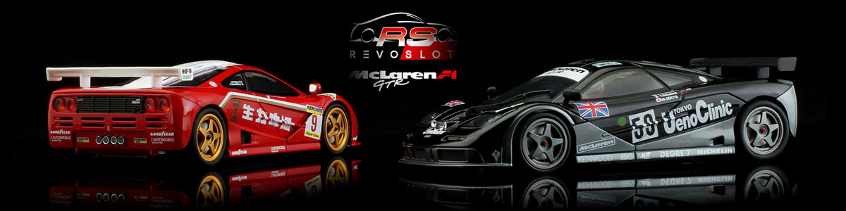 Two Revoslot Mclarens in red and black liveries